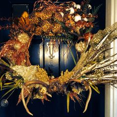 Fall wreath on my front door, with 6 pt whitetail antlers attached!