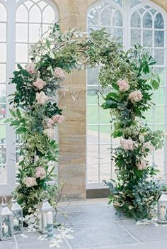 Floral wedding arch, leafy foliage arch dotted with blooms can be constructed around a doorway or free-standing as seen here at Dillington House Orangery. Wedding Arch Flowers, Wedding Flower Decorations, Wedding Centerpieces, Floral Wedding, Wedding Arches, Backdrop Wedding, Wedding Props, Wedding Ideas, Ceremony Decorations