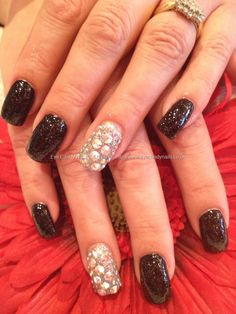 Swarovski crystal nail art - I am soooo into this look right now. I just ordered a bunch of swarovski crystals to try it!