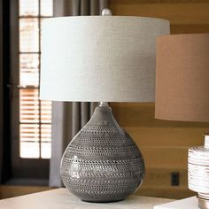 Smoke and the city come to mind with our sleek mid-century modern Clermont Table Lamp. The rounded, gently tapering textured ceramic base comes in a warm,    glossy smoke gray-fired glaze. We call it neutral-but-better, due to the deep, tonal sophistication of the coloring. The lamp is perfectly topped    with a slubbed linen shade in beige for a more custom look.            Sleekly rounded mid-century modern ceramic table lamp                Textured ceramic base comes in a warm, glossy ...