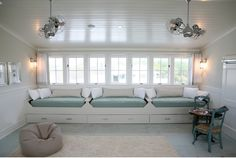Great bunk room or bonus room idea, window seat beds with storage. http://urbangraceinteriorsinc.com/