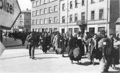Jews being marched out of the Krakow ghetto in March 1943.  On 13th-14th March around 8,000 people, the last survivors of the pre war Jewish population of around 90,000 people in Krakow, were sent to the Plaszow concentration camp.