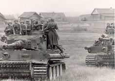 Tigers with infantry. Note the second Tiger: An infant soldier is hanging on the barrel :)