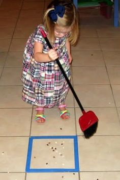 Make chores fun!  Learn to sweep while using large motor skills. Maybe this will help keep Eddie from sweeping my pile all over the house while I'm cleaning!