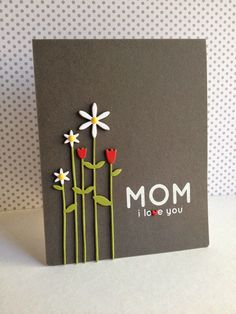 Tall Flowers die cuts produce the tulips and daisies on this handmade mother's day card.  Layer them several times and they practically jump off the page.