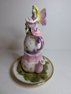 Hey, I found this really awesome Etsy listing at https://www.etsy.com/listing/213988782/fairy-teapot-tower-fairy-garden-unique