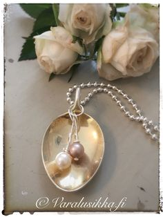 Hand made spoon necklace with Swarovski pearls made from silver plated vintage spoon. www.varalusikka.fi