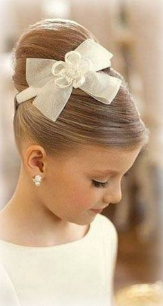 Flower girls hair and hair piece (except our girls have a light blue flower inside the bow)