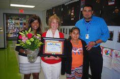Dr. Ellen Teelucksingh, Julio Lopez, and Celia Ruiz congratulate Dana Yala on her Champions of Literacy award. Kathy Ryan