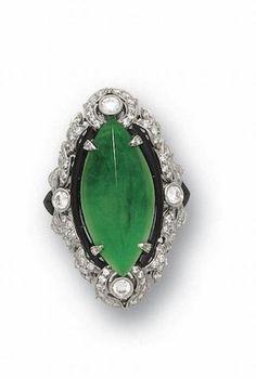 A jadeite, onyx and diamond ring