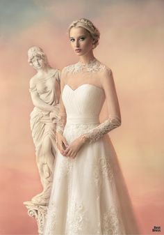Papilio 2015 - Stunning long sleeve wedding gown with delicate lace neckline and high neck. Bringing visions of Grace Kelly.