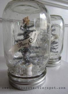 Cute mini Merry Christmas tinsel tree in a jar