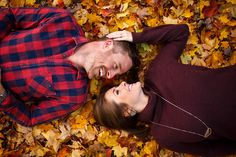 Fun outdoors fall leaves engagement session.