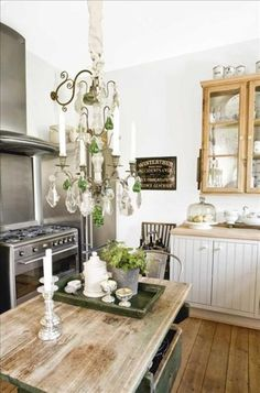 Eclectic chandelier in a country like kitchen. Great combinations!