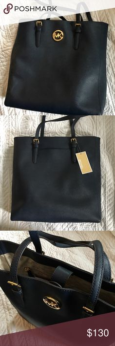 Michael Kors Navy Blue Jet Set Travel Tote Bag This new tote bag would be perfect for taking to work, school, on vacation or even to lunch. Plenty of pockets to store your things and keep things organized. Michael Kors Bags Totes