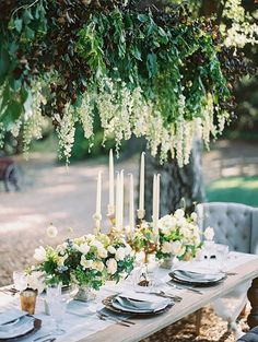 Cascading flower chandelier: http://www.stylemepretty.com/collection/1962/ Photography: Bryan N. Miller - http://www.bmillerweddings.net/