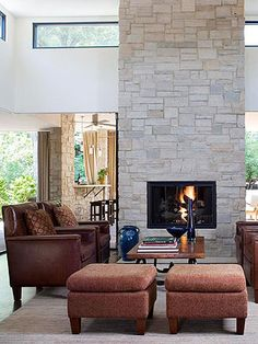 Perk up an old fireplace with this DIY fireplace remodeling project that uses stone veneer to completely transform the look of a fireplace facade.
