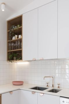 Open kitchen shelf in the corner along with closed cabinets in white
