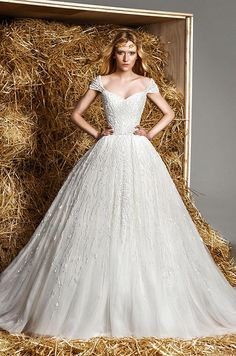 Stunning Zuhair Murad ball gown wedding dress with cap sleeves.