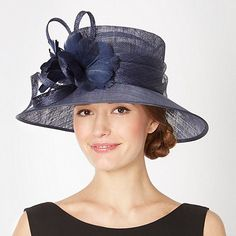 This elegant navy occasion hat from Hat Box has a turned down brim with two soft feather flowers and a spiralled loop detail at the side.
