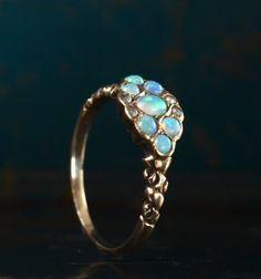 I'm so enamored of antique opal rings.