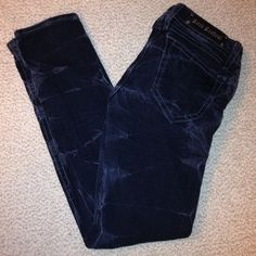 Rock Revival Jeans These Rock Revival straight leg stone washed jeans has a distressed grey washed design in the jeans. They are a size 30 x 30 inches in length. They are 98% cotton and 2% Elastin.Mid rise Rock Revival Jeans