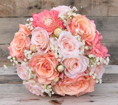 Love these silk flowers in coral, peach and melon tones!  Bouquet by Holly's Wedding Flowers.