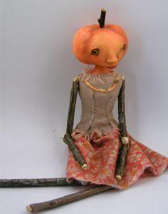 contemporary folk art doll cloth clay pumpkin by Cindy Riccardelli, $100.00