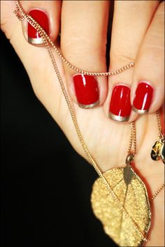 Amazing nails: gorgeous red/gold french. Sassy.