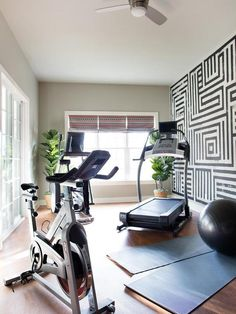 gym furniture. Amazing Home Gym And Yoga Room Boasts A Black White Graphic Hand Painted Wall Alongside Furniture