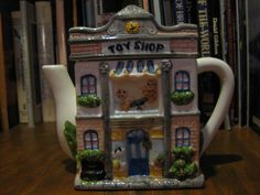 This TOY SHOP teapot (front) is impressed Made in China Starite Industries Inc.