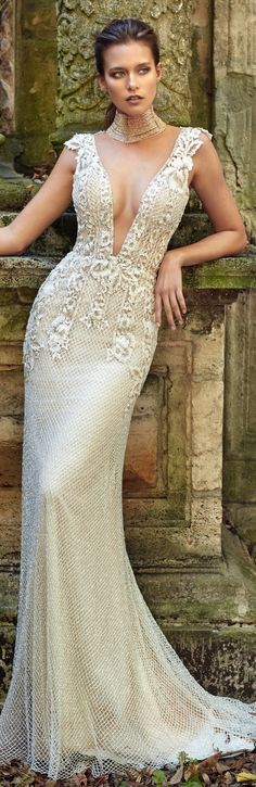 Glamorous mermaid silhouette, made of a very sparkly beaded net and a modern applique of stripes and roses, in a two-toned Nude and Ivory combination. A wedding gown made with love from Galia Lahav. #marriage #wedding #dress