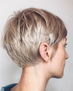 We love the pairing of a classic baby platinum blonde with a summery pixie hair . - - We love the pairing of a classic baby platinum blonde with a summery pixie hair cut. Work by Aveda Artist Stefanie Gottschalk and Julia Hannappel. Bold Haircuts, Short Pixie Haircuts, Blonde Short Hair Pixie, Thick Hair Bangs, Shaggy Pixie Cuts, Long Pixie Hairstyles, Short Grey Hair, Wedding Hairstyles, Short Hair Cuts For Women