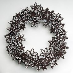 Cookie snowflake wreath.  If we did chocolate cookies with pink/white icing.... so cute!  Could be a great alternative to making cupcakes for everyone.