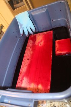 Cherry red RIT liquid dye on wood. Easy dye process- soak wood 5 minutes each side; lay on towel to dry. No fumes, etc. http://www.shanty-2-chic.com/2011/12/photo-blocks-using-rit-dye.html