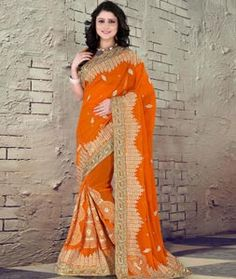 Buy Orange Faux Georgette Saree With Blouse 76435 with blouse online at lowest price from vast collection of sarees at Indianclothstore.com.