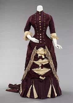 c. 1800 ... Afternoon dress ... American ... silk & abalone ... The nuances and contrasts between the plain faille against the subtly figured aubergine and cream silk are particularly effective on this gown. The train in particular shows interesting contrasts. Using that kind of detail on the train shows the level of awareness and scrutiny under which the design of the dress would be under. ... at The Metropolitan Museum of Art ... photo 1