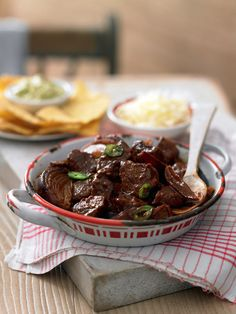 This recipe cooks steak with red onions, cumin, sweet paprika and cocoa powder until it's tender and sticky. A perfect midweek meal when served with nachos, guacamole and soured cream.