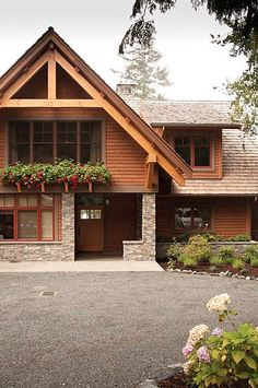 Pacific Northwest Home Exterior, Lodge style Home Inspiration, Wood and Rock Fixture, Craftsmen Style Architecture Home Inspiration.