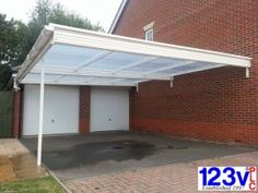 Large carport with only one post. will cover 2 car with room to spare. In and out of the garage in the dry. 123v plc. #LargeCarport