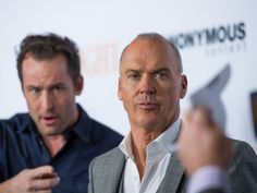 """Michael Keaton, center, takes in the scene at the premiere of """"Spotlight"""" on Tuesday, in Los Angeles.  Valerie Macon, AFP/Getty Images"""