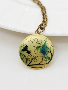Hummingbird LocketLocketBrass LocketImage by emmagemshop on Etsy, $26.99
