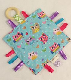 A personal favorite from my Etsy shop https://www.etsy.com/listing/238172415/crinkle-blanket-baby-crinkle-toy-crinkle