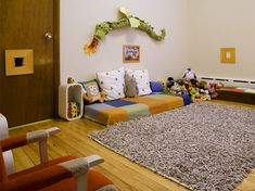 I love the peep hole in the door...In this Montessori-inspired bedroom, this little boy's mom (an educator at a Montessori school), says she decided to place the mattress directly on the floor. This way, her toddler can feel independent enough in getting in and out of bed on his own. Interesting idea.