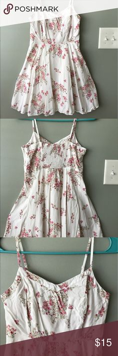 Spaghetti strap white floral print dress Such a pretty dress! Perfect for the occasion when you don't know how formal to be but still want to look nice! Wear for brunch, church, dates, barbecues and croquet, anything! Pair with some comfortable ballet flats of a classic nude heel. Great for the spring time and summer! Old Navy Dresses