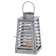 """Openwork iron candle lantern.     Product: LanternConstruction Material: IronColor: Aged silverAccommodates: (1) Candle - not includedDimensions: 12"""" H x 7"""" W x 7"""" DCleaning and Care: Wipe with dry cloth"""
