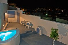 Luxury santorini rooms and traditional santorini villas as best promise to enjoy your stay at santorini island Santorini Suites, Santorini Island, Santorini Greece, Dining Buffet, Dining Table Chairs, Small Fridges, Jacuzzi Outdoor, Comfortable Living Rooms, Gala Dinner