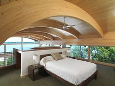 Small and simple, but that curved wood roof sure adds elegance to the interior.
