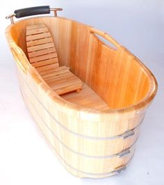 Turn any bathroom into an eye catching spectacular with a high end wooden tub. The perfect addition to any log style cabin or winter home. Nothing feels better than crawling into a tub made of wood and filled with steaming hot water. Just lay back and relax, you're in a classic wooden tub.    Let us know what you think!