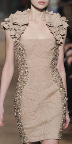 Dress with origami fabric shoulder detail, geometric textures & beaded embellishments; couture sewing // Tony Ward
